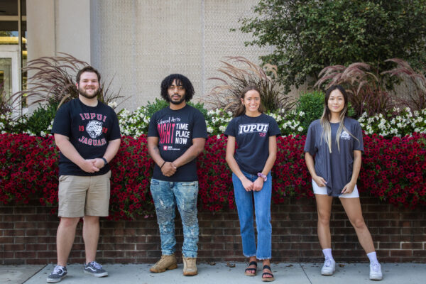 Journalism and public relations students pose in front of Cavanaugh Hall