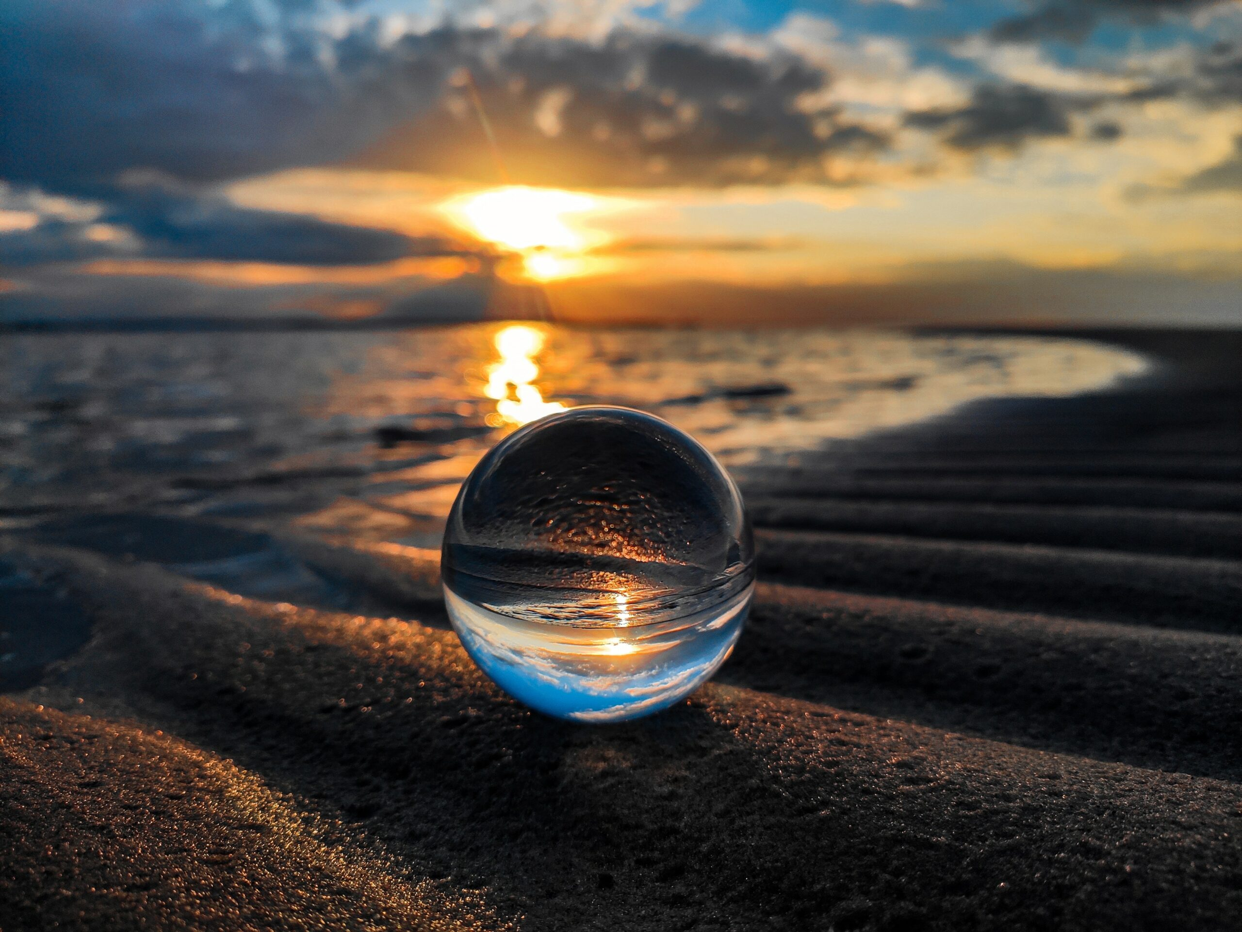 Sphere reflects sun image