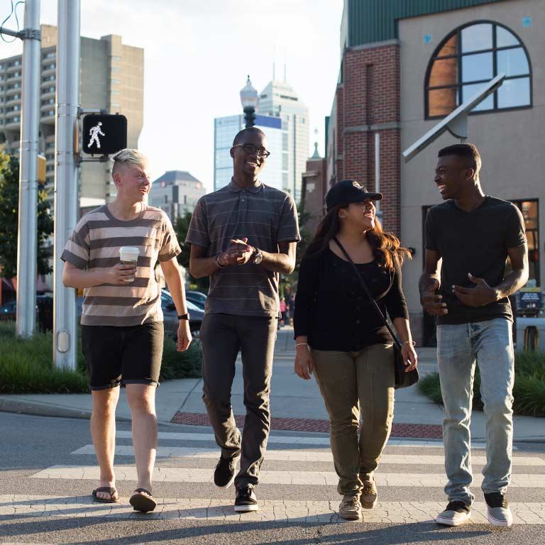 Four students cross the street in Indianapolis.