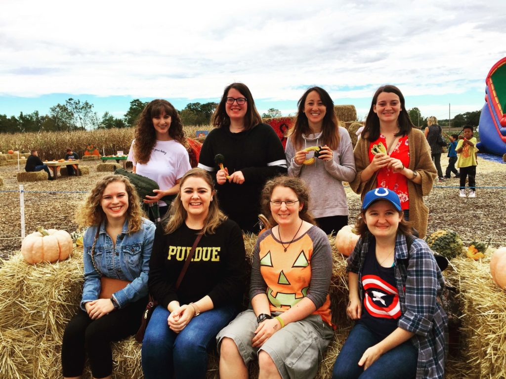 Club members on a trip to a pumpkin patch.