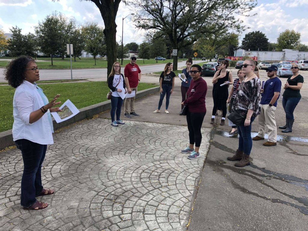 Phyllis Boyd, Executive Director of Groundwork Indy, leads students in the Climates of Inequality research seminar on a tour of the Riverside neighborhood.