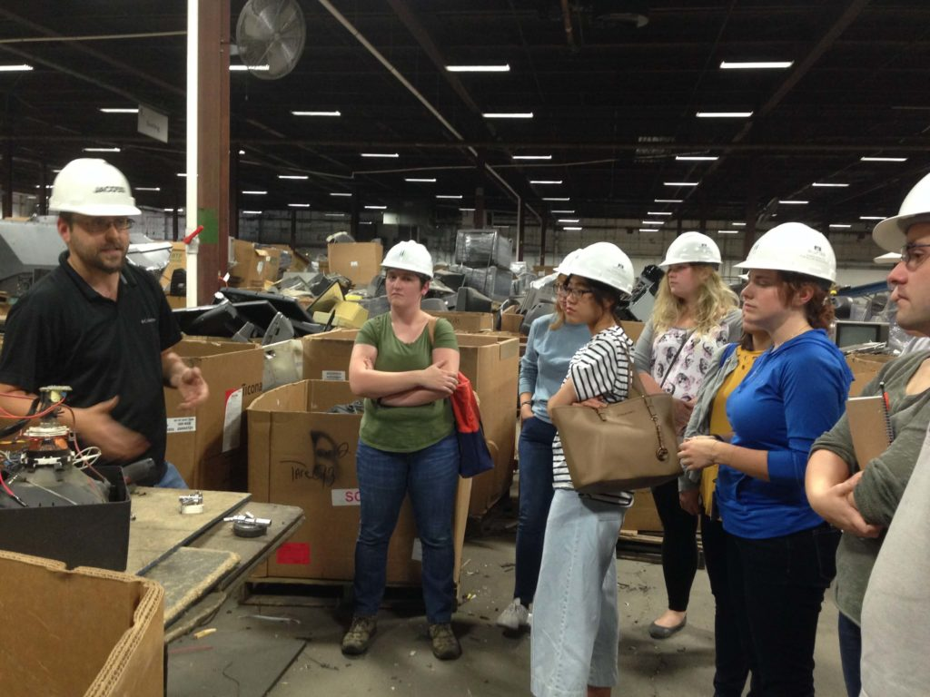 Students visit RecycleForce, an Indianapolis-based nonprofit, during the development of the States of Incarceration exhibit.