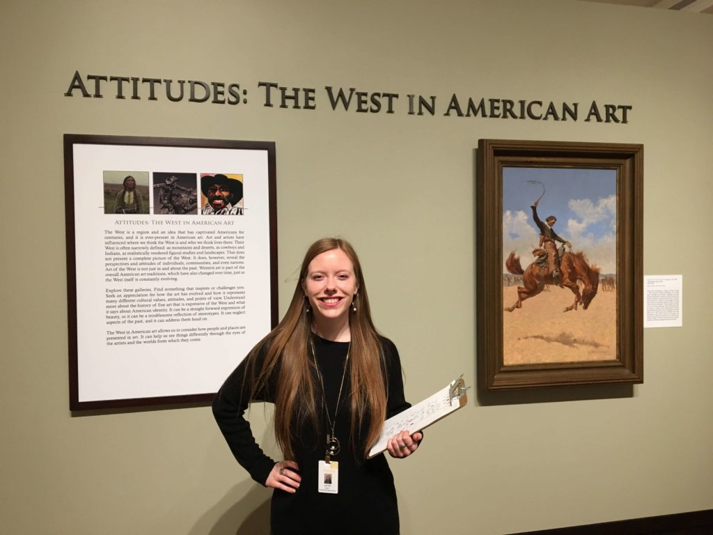 A student conducts visitor surveys during her internship.