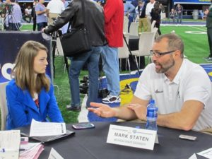 Elizabeth Cotter speaks with Michigan State offensive line coach Mark Staten on Dec. 29 at AT&T Stadium in Arlington, Texas.
