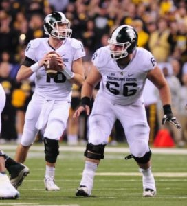 Michigan State center Jack Allen (66) looks to protect quarterback Connor Cook during the Big Ten Championship game on Dec. 5. (Photo courtesy Michigan State)