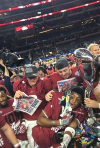Alabama players strewn in confetti celebrate on the field at AT&T Stadium in Arlington, Texas, following their 38-0 rout of Michigan State in the College Football Playoff semifinal. The Crimson Tide will play No. 1 Clemson in the College Football National Championship game on Jan. 11 in Glendale, Arizona. (Photo by Jessica Wimsatt)