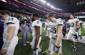 Michigan State players leave the field after the Cotton Bowl loss to Alabama on Dec. 31, in Arlington, Texas. Alabama won 38-0 to advance to the championship game. (AP Photo   Tony Gutierrez)