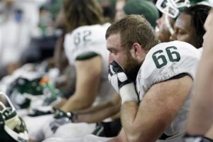 Michigan State center Jack Allen reacts in the final minutes of the Cotton Bowl loss to Alabama on Dec. 31 in Arlington, Texas. Alabama won 38-0 to advance to the championship game. (AP Photo | Tony Gutierrez)