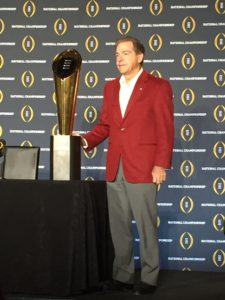 Alabama head coach Nick Saban poses with the College Football Playoff National Championship trophy on Jan. 12, the day after winning his fifth overall title and fourth in seven seasons at Alabama. (Photo by Malcolm Moran)