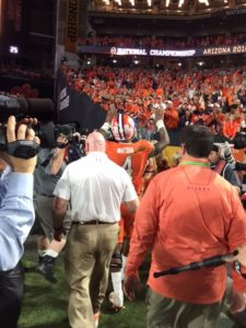 Clemson Tigers sophomore quarterback Deshaun Watson waves to Tigers fans as he leaves the field following the 45-40 loss to the Alabama Crimson Tide in the College Football Playoff National Championship on Jan. 11 at University of Phoenix Stadium in Glendale, Ariz.